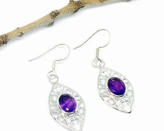 10% Amethyst earrings set in Sterling silver (92.5). Genuine natural faceted amethyst stones. Perfectly matched