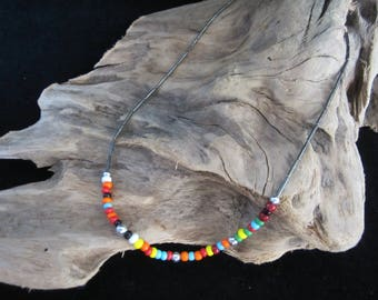 Unisex Choker - center section strung with small multi-color ceramic beads. Smoky tubular glass beads on each side finishes the piece! Gift!