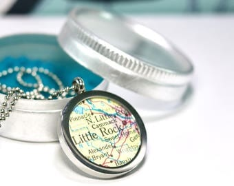 Medallion of your favorite city with vintage maps. Personalized