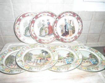 7 Vintage Dahem Decorated ware metal plates made in Holland.