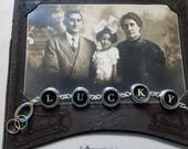 Vintage typewriter key bracelet spells Lucky black and white letters