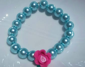 Pearl flower girl bracelet with pink polymer clay flower for your special wedding day.  11 colors to chose from.  Turquoise pearls in photo