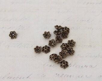 20 caps metal flowered bronze 6mm