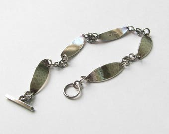 Sterling Silver Oval  Plate-link Bracelet. Hammered Texture with Toggle Clasp. Hallmarked.