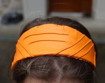 Ribbed headband orange leatherette