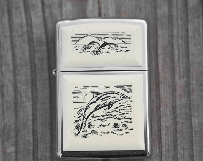 Scrimshaw Zippo with Dolphins unfired