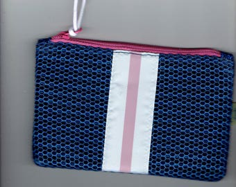makeup bag is navy blue with yellow ribbon and hot pink stripe 1990