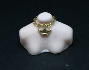 Bust With Gold Crown Necklace