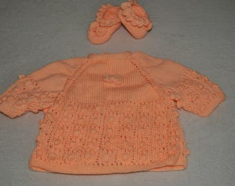 entire jacket and booties with orange color with knots and beads