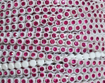 SS8 White Rhinestone Banding with a Fuchsia Stone - Sold by the yard