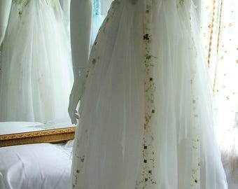 Reserved. Woodland lace up wedding dress tattered ragged shabby cottage etheral angel one of a kind. Size 4 - 8. White and green