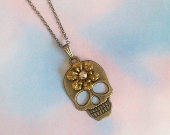 Brass flower skull necklace