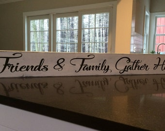 "Friends & Family Gather Here.  Painted wood sign measures 48"" x 5.5""."