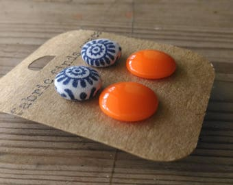 2 pairs of stud earrings, one 15mm vintageorange glass cabochons  and one 12mm vintage blue and white fabric covered button. so boho!