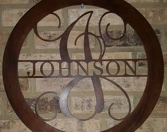 Personalized metal monogram with name and established date