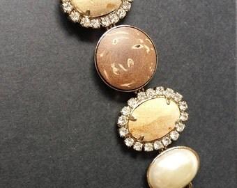 Motif cabochon bois et perles serties strass