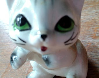 cat figurine made out of porcelain,made in Japan