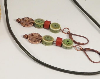 Earrings made of ceramics and celery green.