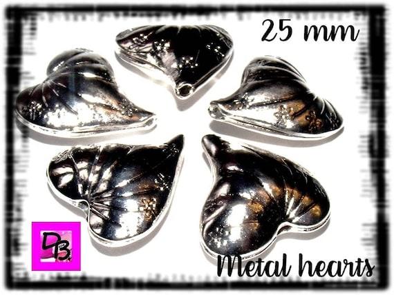 2 perles [cœurs en pointe]  25 mm