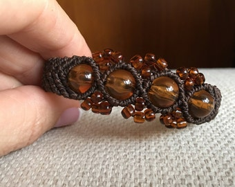 Macrame bracelet brown waxed cord and adjustable closure with matching beads