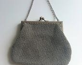 Vintage evening bag in silver from late 1950s. Woven structure silver chain handle pale blue lining.