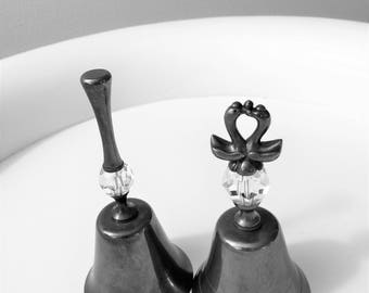 Set of two Silver Dinner Bells with  Crystal Section in the Handle - two swans or ducks kissing at the top