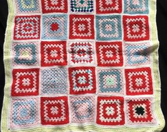 Multicoloured handmade crocheted blanket