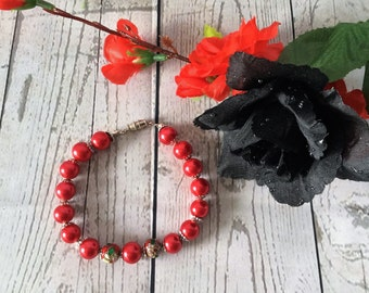 Bracelet, beaded with candy apple red beads.