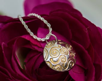 Sterling silver pendant with gold swirls