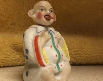 Antique German bisque porcelain baby figurine with moving head and poking tongue