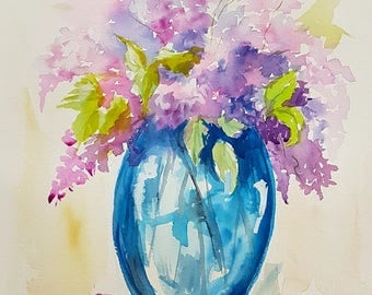 Gorgeous wisteria in blue vase