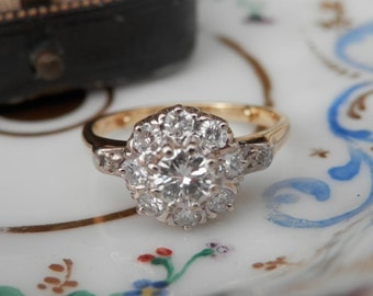 Vintage diamond daisy cluster engagement ring, 18ct gold, Guild of Valuers report, 0.73ct diamonds, ring size K