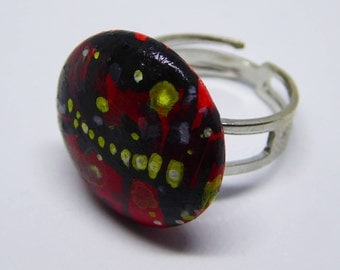 Adjustable ring with hand-painted leatherette button.