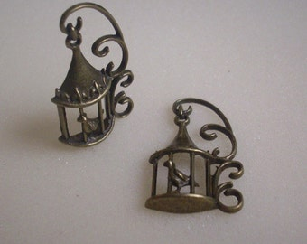 2 CAGE to bird pendants/charms