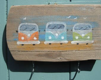 Camper vans hand painted on driftwood with hooks.