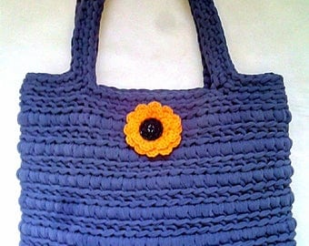 Blue ribbon bag with orange flower
