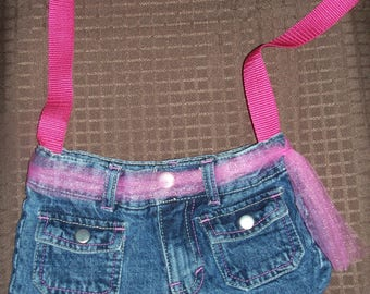 Denim purse with pink accents