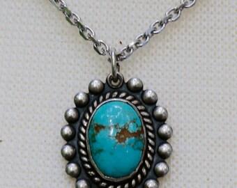 Oval shaped Turquoise Southwestern Style Pendant