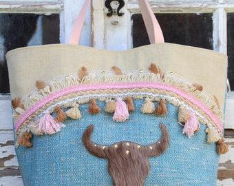 Bag canvas Blue Heather, linen ecru embellished braid tassels, lace, pink, gold braid, brown feathers.