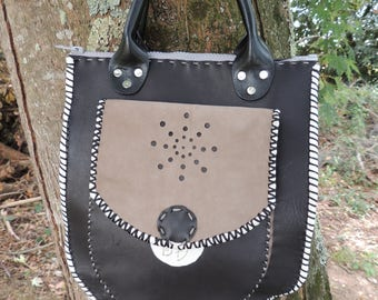 black and grey leather bag sewn by hand