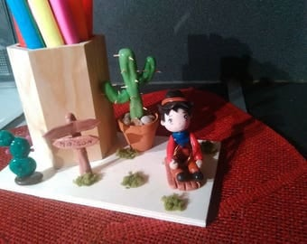 Pencil pot: Mael is a cowboy made of cold porcelain.