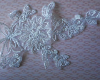 Lace white applique organza embroidered with flowers and silver threads 27,00 cm in length.