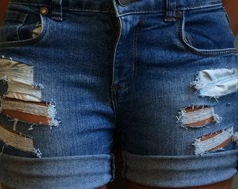 Juniors hand distressed denim shorts