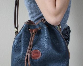 Vintage Dooney & Bourke Medium Drawstring Bucket Bag in Navy + Brown