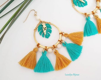 Tropical asymmetric tassels weave Pearl Tagua (vegetable ivory) - Parrot charm and Philodendron leaf earrings