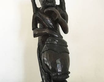 Caribbean Mahogany Sculpture - Man with Dreadlocks Playing Congas