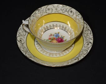 Vintage, Teacup, and saucer, Yellow band, gild filigree, floral design in center, Gold Rimmed, England, Bone China, Tea Cup