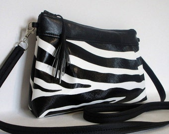 Faux leather Zebra and black faux leather clutch bag