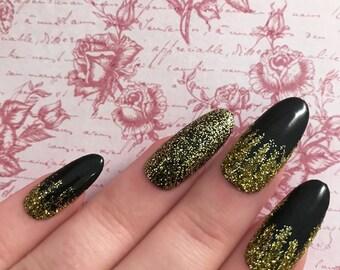 Black gloss & gold glitter. Hand painted black and gold glitter gel false nails