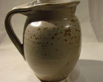 white stoneware pitcher